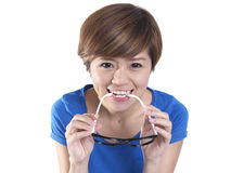 Close up of tomboy asian chinese girl wearing spectacles. Asian tomboy female girl in blue top posing and smiling to the camera Royalty Free Stock Photography