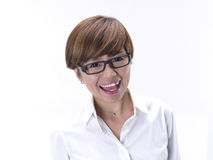 Close up of tomboy asian chinese girl wearing spectacles. Asian tomboy female girl in blue top posing and smiling to the camera Stock Photography