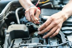 Close up tool and hand of People or mechanic car repair during investigate cause of problem electric system check or working on. Automobile gasoline or diesel stock photography