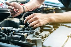 Close up tool and hand of People or mechanic car repair during investigate cause of problem electric system check or working on. Automobile gasoline or diesel stock image