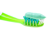 Close-up of a toothbrush with paste on white Royalty Free Stock Image