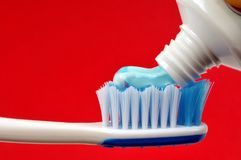 Put toothpaste on a toothbrush stock photos