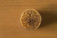 The close up toothpicks. On the wooden table stock image
