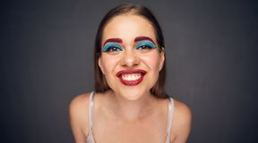 Close up toothy smiling face portrait of funny woman. With make up Royalty Free Stock Photography