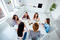 Close up top above high angle view photo beautiful she her ladies group best friends sit round big white table bright. Close up top above high angle view photo royalty free stock images
