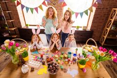 Close up top above high angle view photo three children mom granny made decorated eggs easter symbols weekend children stock images