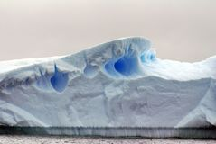 Close up of an iceberg in Antarctica. Close up of the top of an iceberg with a blue tint in Antarctica