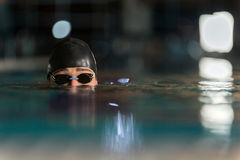 Close up of the top of a male swimmers head. Close up of the top half of a male swimmers head submerged in a swimming pool Stock Images