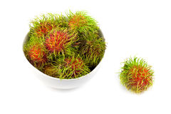 Close up top side  rambutan in dish. On white background Stock Image