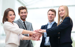 Close up top view of business people putting their hands togethe Stock Photos