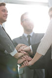 Close up top view of business people putting their hands togethe Royalty Free Stock Photo