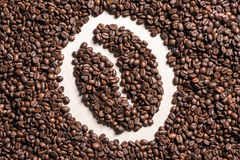Close-up top view of coffee bean symbol made from roasted coffee grains Stock Photo