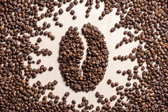 Close-up top view of coffee bean symbol made from roasted coffee grains Stock Photos
