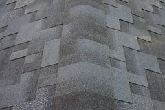Close up top view on corner roof made is asphalt roofing shingles. Royalty Free Stock Photography