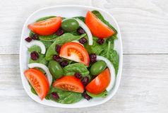 Close up Top View of Fresh Salad in plate on White wood Stock Image