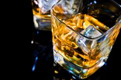 Close-up of top of view of glass of whiskey on black table with reflection Royalty Free Stock Photos
