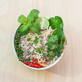 Close-up Top view after hot water bowl. Of instant noodles and Spices, vegetables on wooden Stock Images