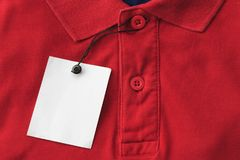 Close up top view of man polo shirt. With blank tags use for texts display stock images