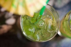 Glass of mojito cocktail Stock Photos