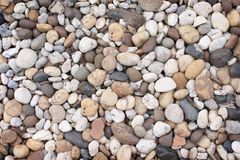 Top view multicolored pebble, rock or gravel pattern for background. Close up Top view multicolored pebble, rock or gravel pattern for background royalty free stock photo
