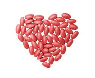 Top view nourishing blood medication tablets and vitamin in heart shaped patterns isolated on white background with clipping path stock photos