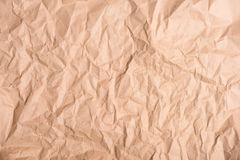 Close-up top view of old brown crumpled. Paper texture stock image