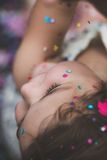 Close Up Top View Photo of Kid's Head Blue and Pink Confetti Royalty Free Stock Photos