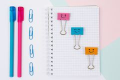 Close up top view photo of school supplies. Set of notepad, pens royalty free stock photos