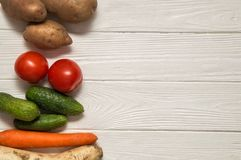 Close up, top view. A plant-based food on white wooden background. Horizontal oriented. royalty free stock photography