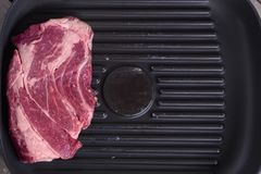 Close-up top view of raw beef steak on grill pan. Copy space. Receipt concept.  Stock Photography