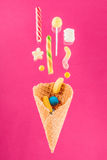 Close-up top view of tasty crispy waffle cone and mix of delicious sweets Royalty Free Stock Images