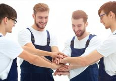 Close up top view of young movers putting their hands together. stock photography