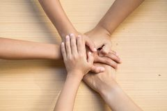Close up top view of young people putting their hands together. royalty free stock photography