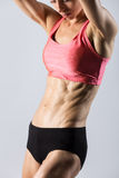 Close-up of torso of beautiful athletic woman Stock Photos