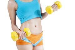 Close-up of torso of female holding barbells Royalty Free Stock Images