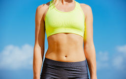 Close-up of torso of fitness woman. Close-up of torso of athletic fitness woman Stock Image