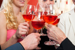Close up Tossing Glasses of Red Wine Stock Photo