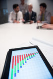 Close up of touchpad with analytics documents at business meetin Stock Images