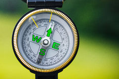 Close up of tourism compass. On green background Stock Images