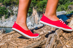 Close up of a tourist girl feet wearing red shoes hiking on cefalonia island, mediterranean, greece Stock Images