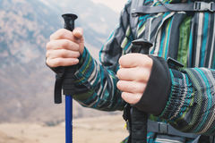 Close-up of a tourist`s hand holding plaques for Nordic walking in the mountains Stock Image