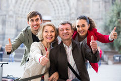 Close up of tourists posing on city street. Close up of smiling tourists posing on European city street Stock Images