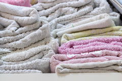 Close-up of towels in bathroom shelf Royalty Free Stock Photography