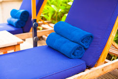 Close-up of towels near swimming pool at tropical Royalty Free Stock Images