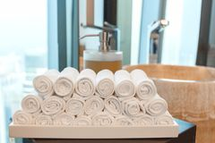 Close up towels with a soap dispenser accessories other in a bathroom stock images
