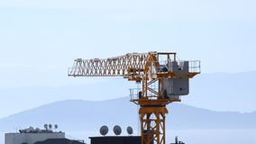 Close up of tower crane swinging slowly with wind in Kadikoy, Istanbul, Turkey. Close up of a tower crane swinging slowly with wind in Kadikoy, Istanbul, Turkey stock footage