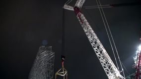 Close-up tower-mounted crane. Special machines on the construction site. Device for a heavy load stock footage