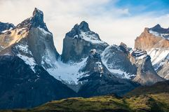 Close-up of towering peaks - iconic Cuernos del Paine, Chile. Close-up of the Cuernos del Paine - towering rocky peaks encrusted with snow and ice - in the Stock Photo