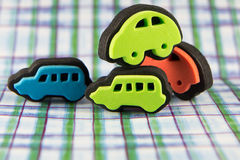 Close-up Toy Car Stamps. Close up of four toy car ink stampers  on funky cool patterned background Stock Photos