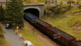 Close-up toy town train tunnel. Close-up toy town train and tunnel stock video